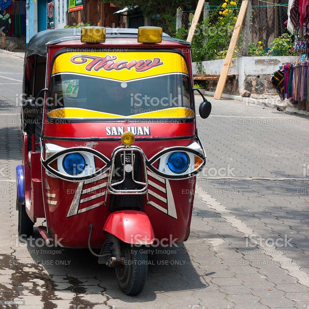Tricycle motor rickshaw taxi (tuk tuk). stock photo