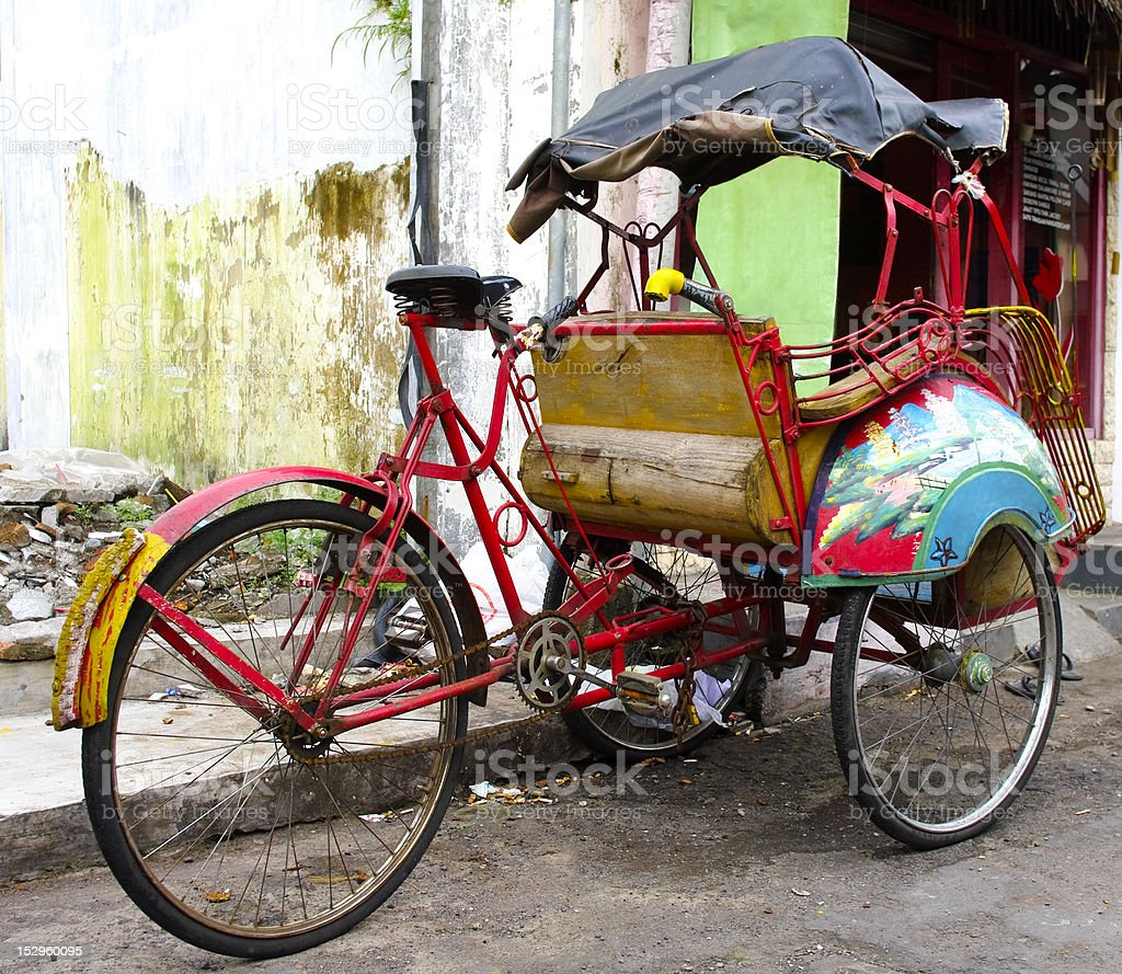 tricycle rickshaws on the streets of Yogyakarta stock photo