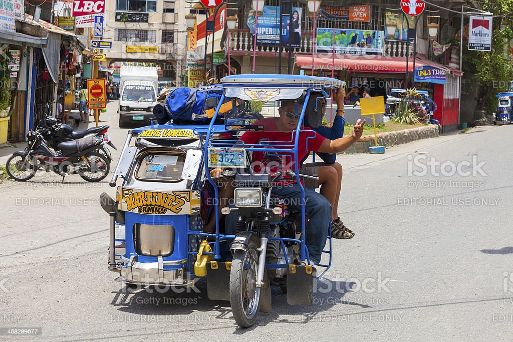 Tricycle, Sabang, Philippines stock photo