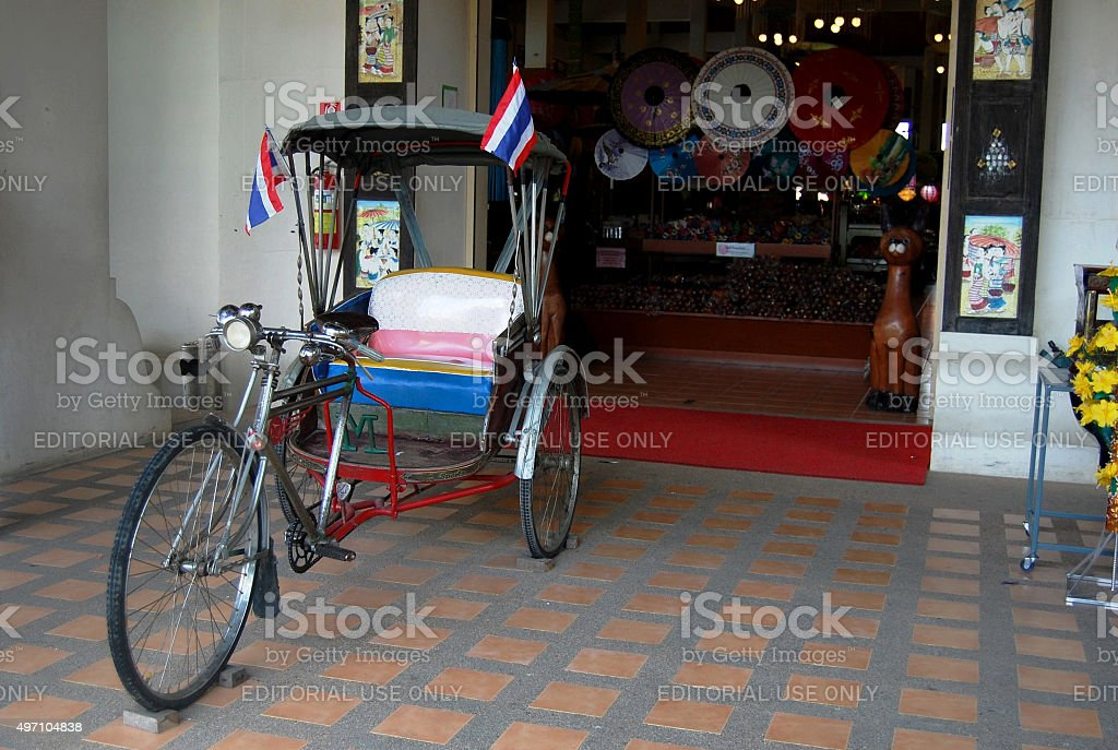 Tricycle thai style at front of shop stock photo