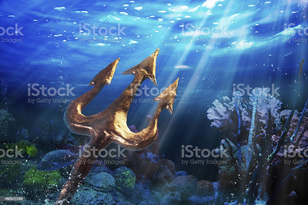 Trident on a dramatic underwater background stock photo