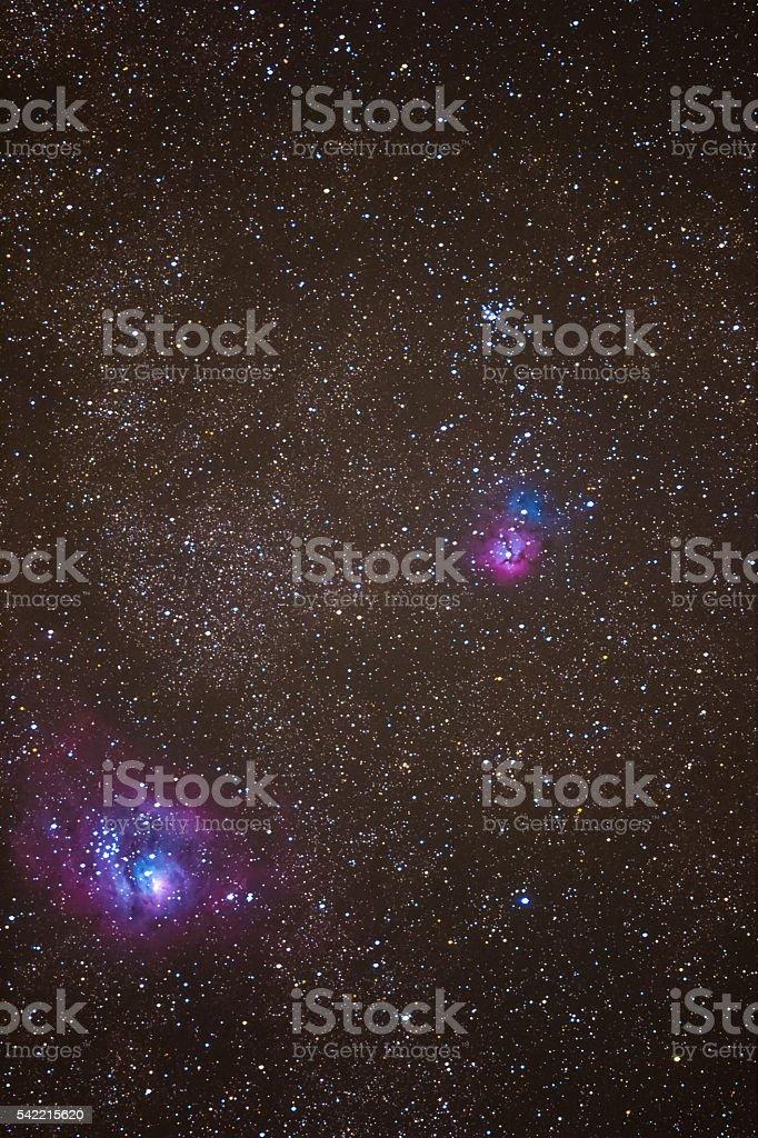 Trifid Nebula and Lagoon Nebula with an amateur DSLR Camera stock photo