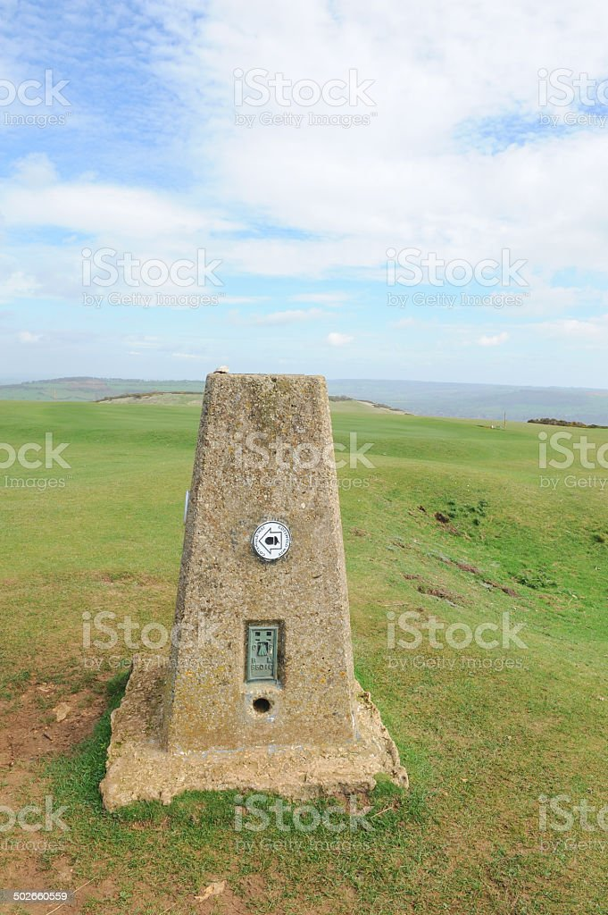 Trig point on top of Cleeve Hill in the Cotswolds stock photo