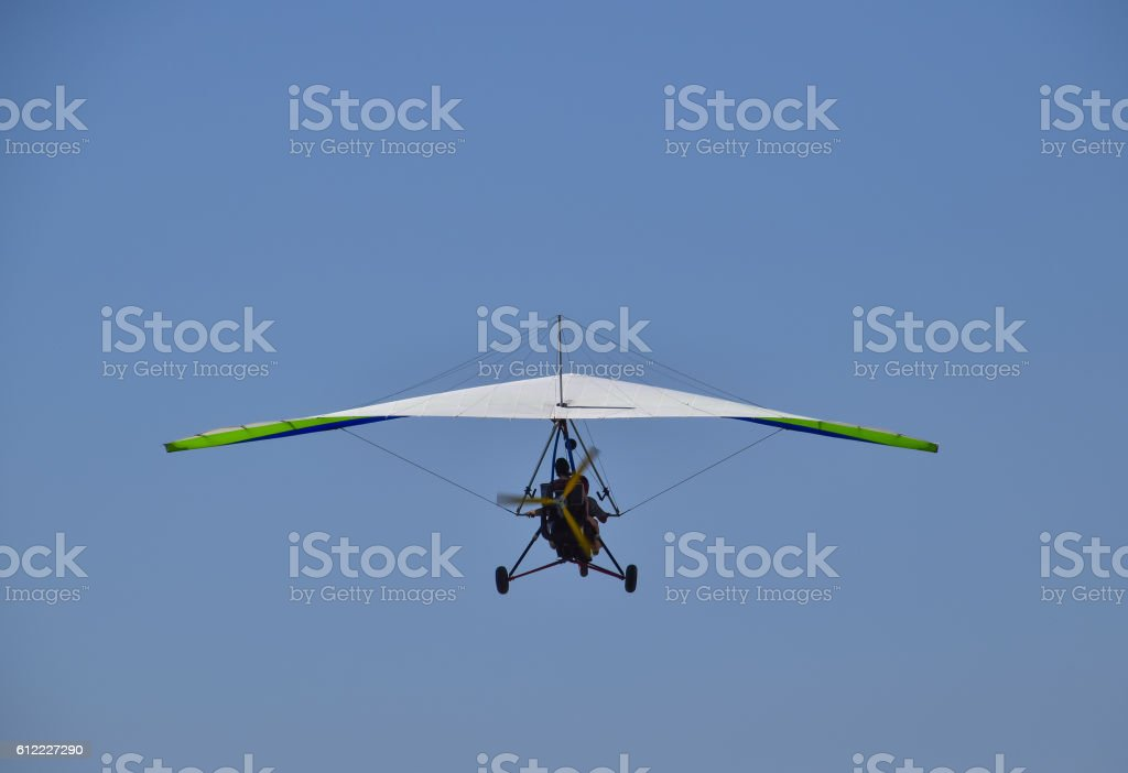 Trike, flying in the sky with two people stock photo