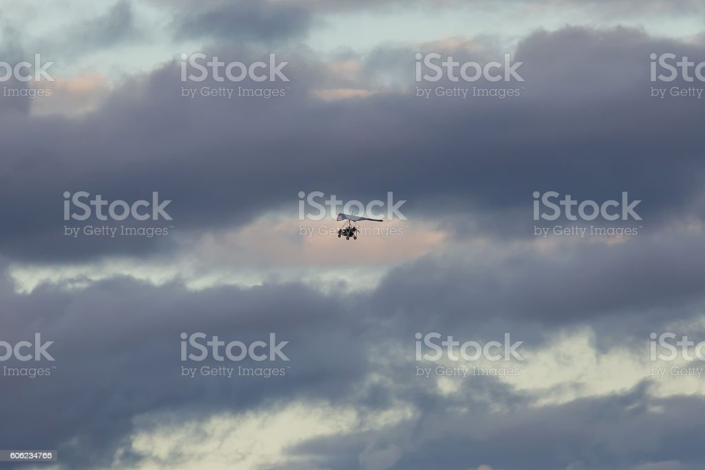 trike on a background of clouds stock photo