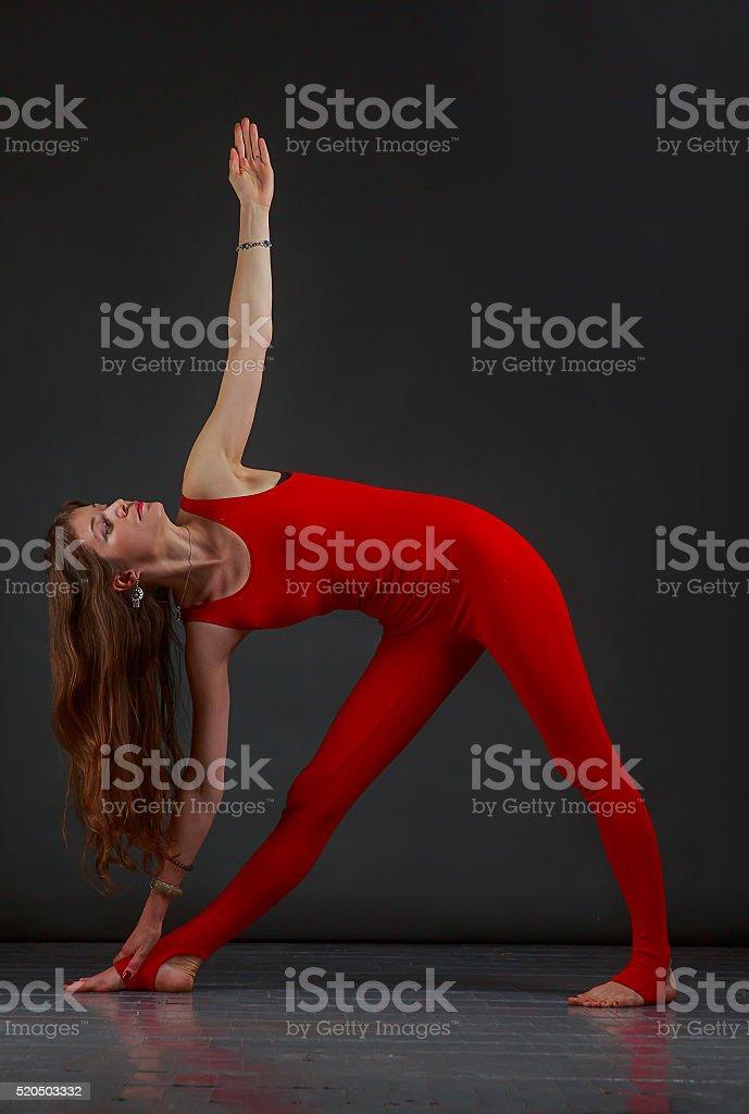 trikonasana yoga stock photo