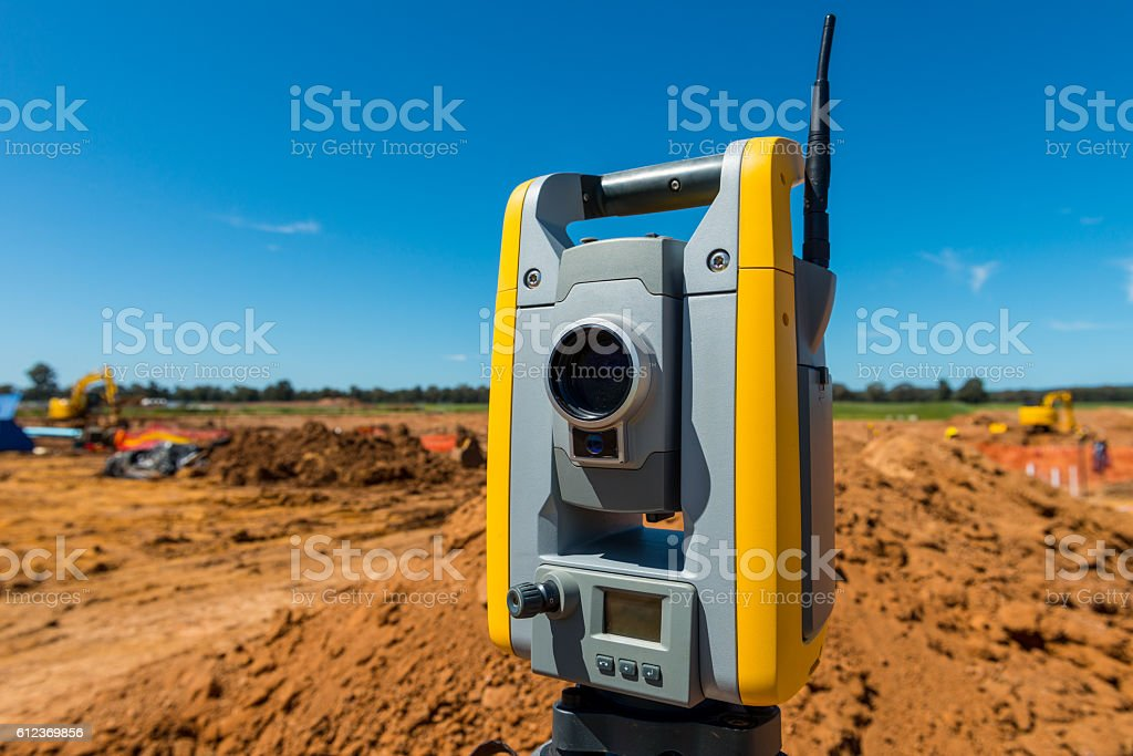 Trimble Total Station on Tripod construction site stock photo