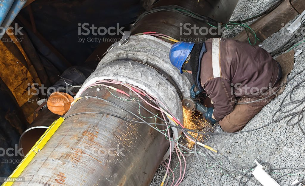 Trimming of the weld by mechanical means stock photo