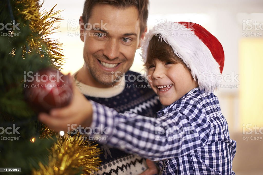 Trimming the tree and feeling festive stock photo