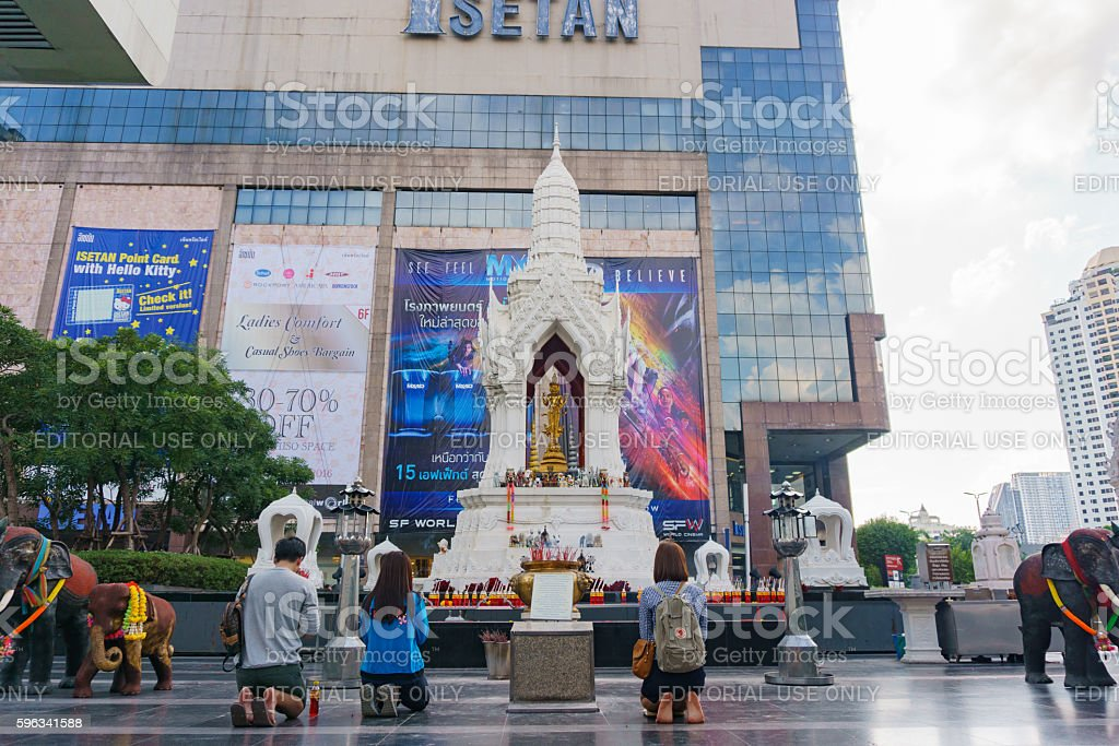 Trimurati buddha statue in front of central world plaza stock photo