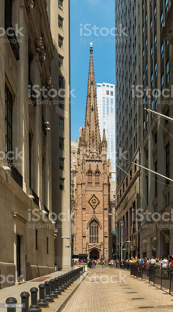 Trinity Church from Wall Street stock photo