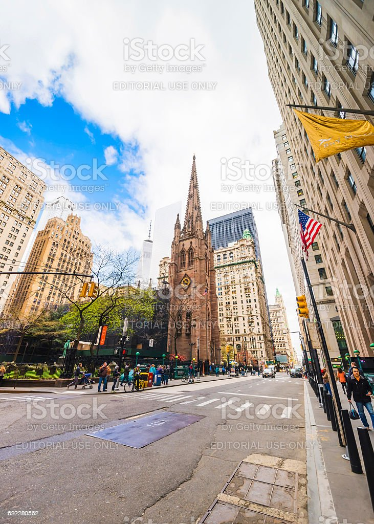 Trinity Church in Manhattan and street with traffic and tourists stock photo