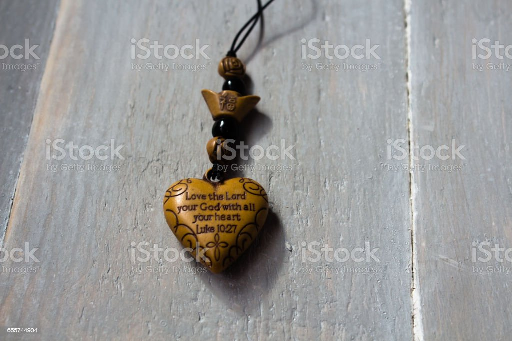 trinket charm with christian message stock photo