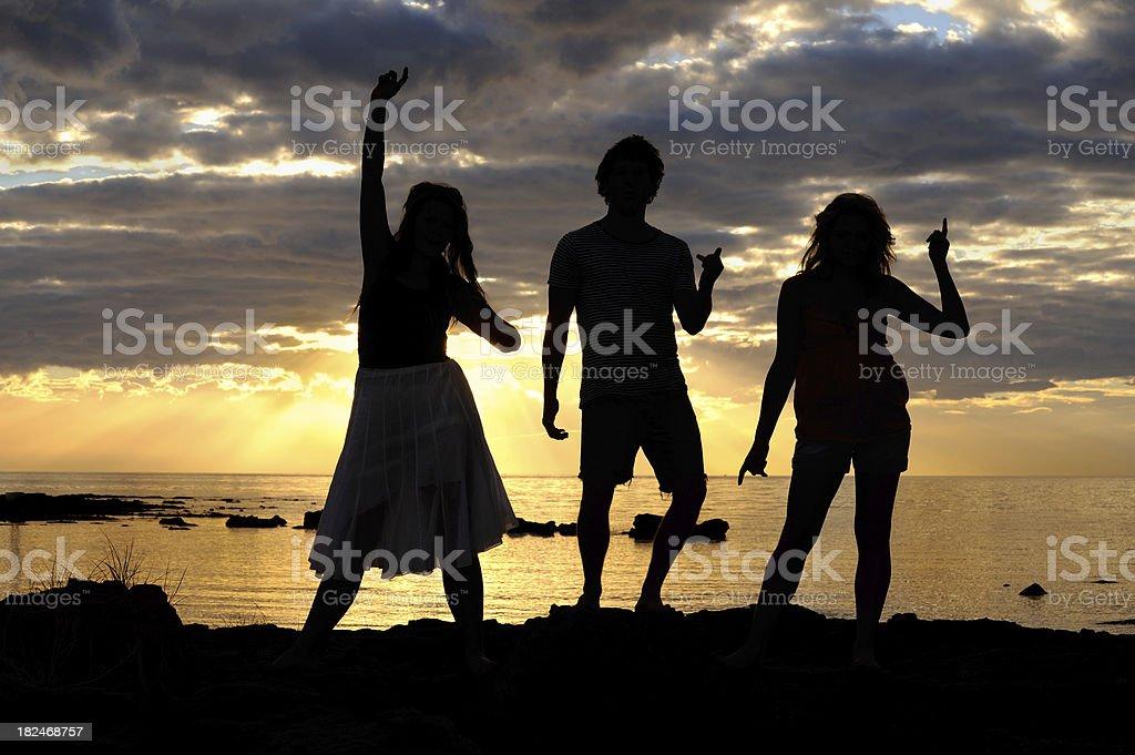Trio Dancing Beach Silhouette royalty-free stock photo
