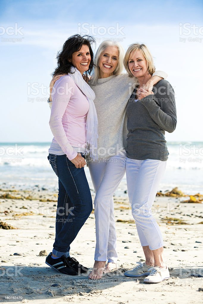 Trio of beautiful mature women at the beach stock photo