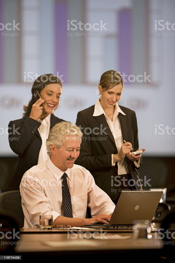 Trio of Businesspeople Looking At Laptop Computer royalty-free stock photo