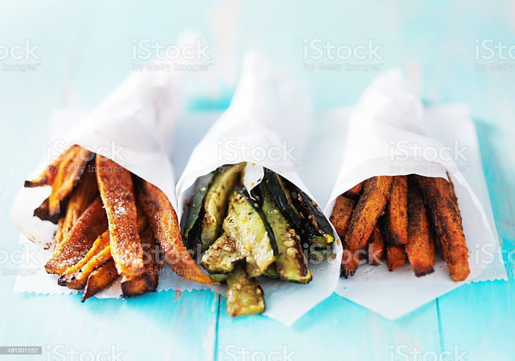 trio of carrot, zucchini, and sweet potato fries stock photo