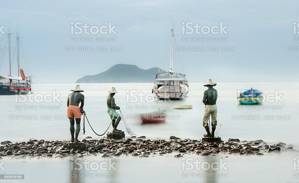 Trio of fishermen statues in Buzios royalty-free stock photo