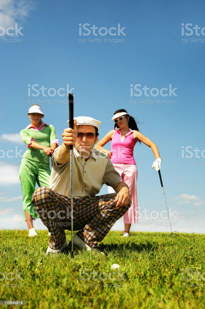 Trio of golfers royalty-free stock photo