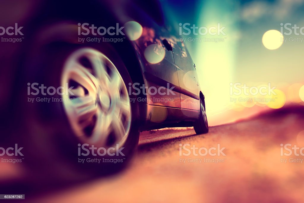 Trip and road .Drive in scenery sunset.Car wheels tire stock photo
