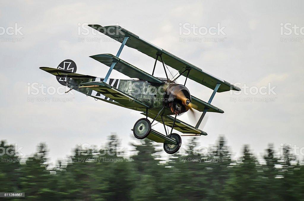 Triplane fighter landing stock photo
