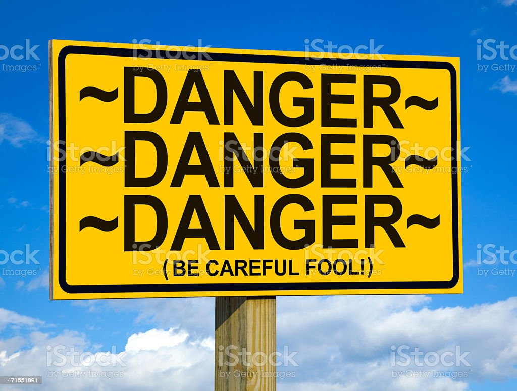 Triple Danger Sign With a Touch of Humor royalty-free stock photo