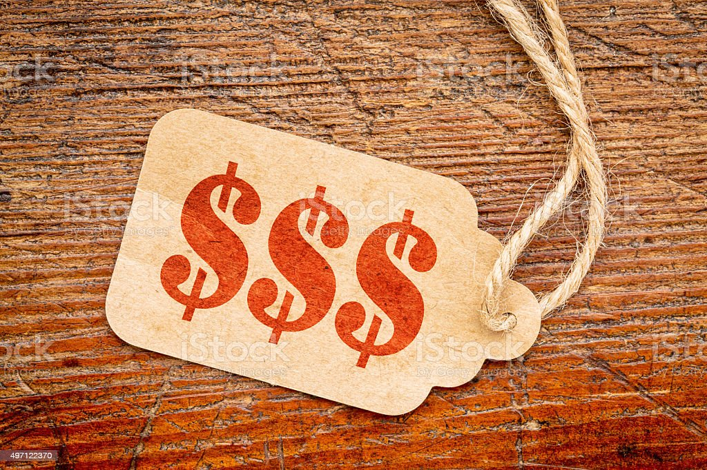 triple dollar sign - price tage stock photo