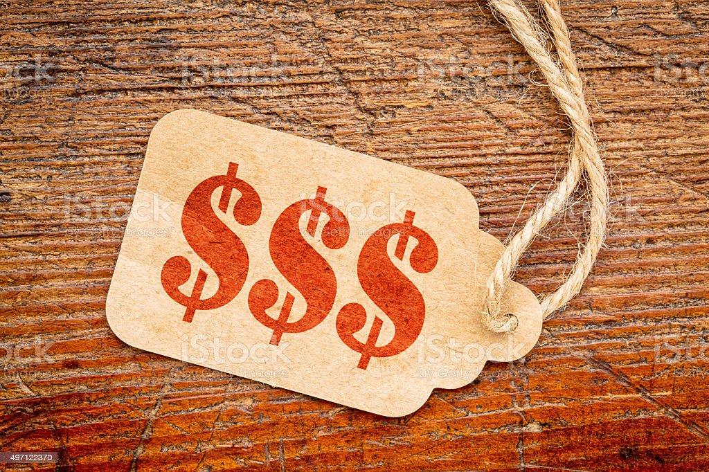 triple dollar sign - price tage stock photo