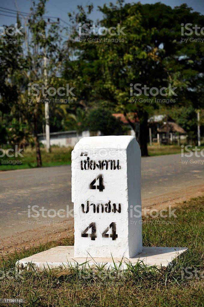 Triple Four Milestone Thailand Grass stock photo