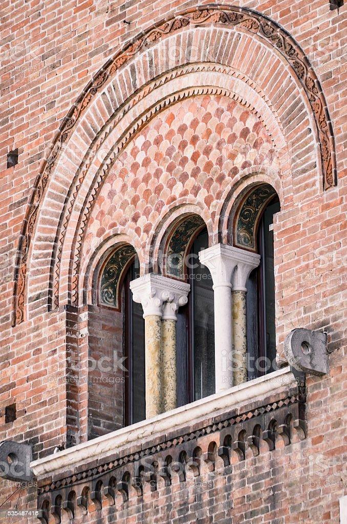 Triple lancet window of medieval palace. stock photo