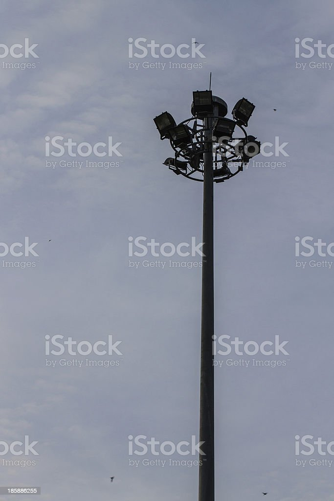 triple layer floodlight that against blue sky stock photo