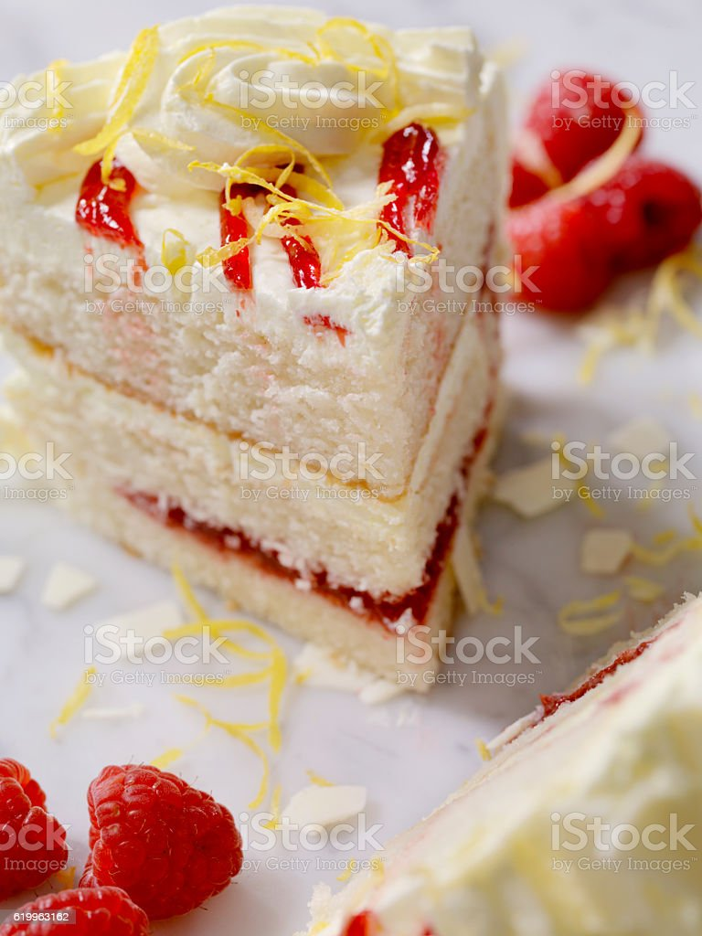 Triple Layered Lemon, Raspberry Cake stock photo