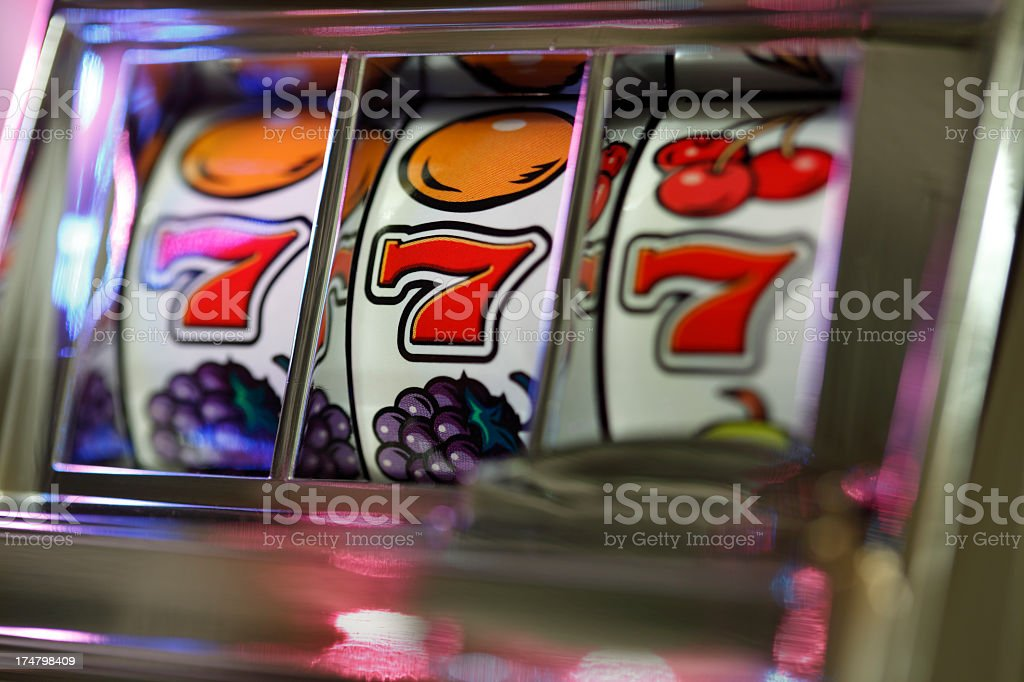A Triple Seven Jackpot on a vintage slot machine stock photo