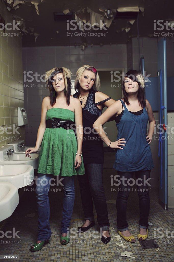 Triple Teen Girls in Insane Asylum Bathroom royalty-free stock photo