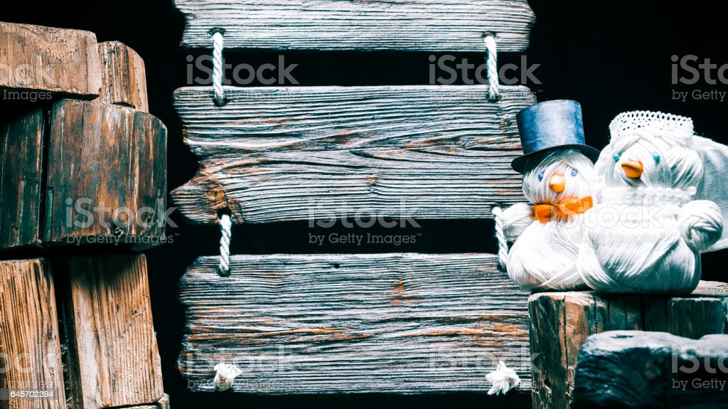 Triple wood sign and wedding couple of snowmen stock photo