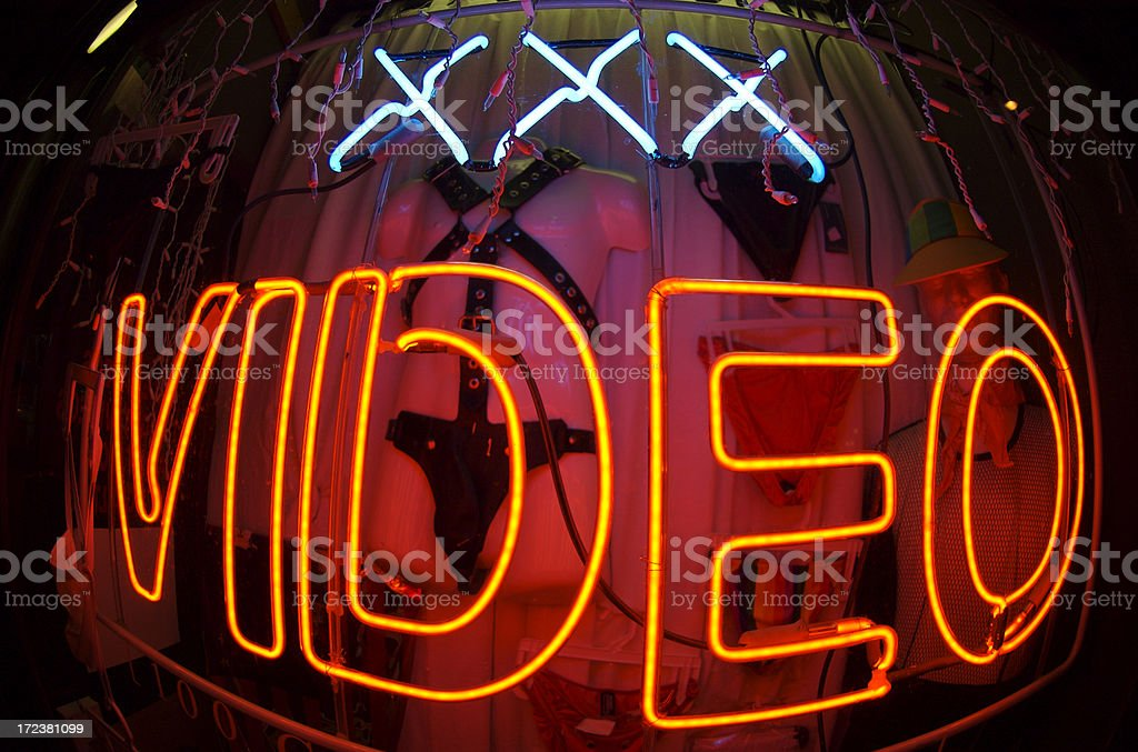 Triple X-Rated Video Bulge Neon Sign at Night stock photo