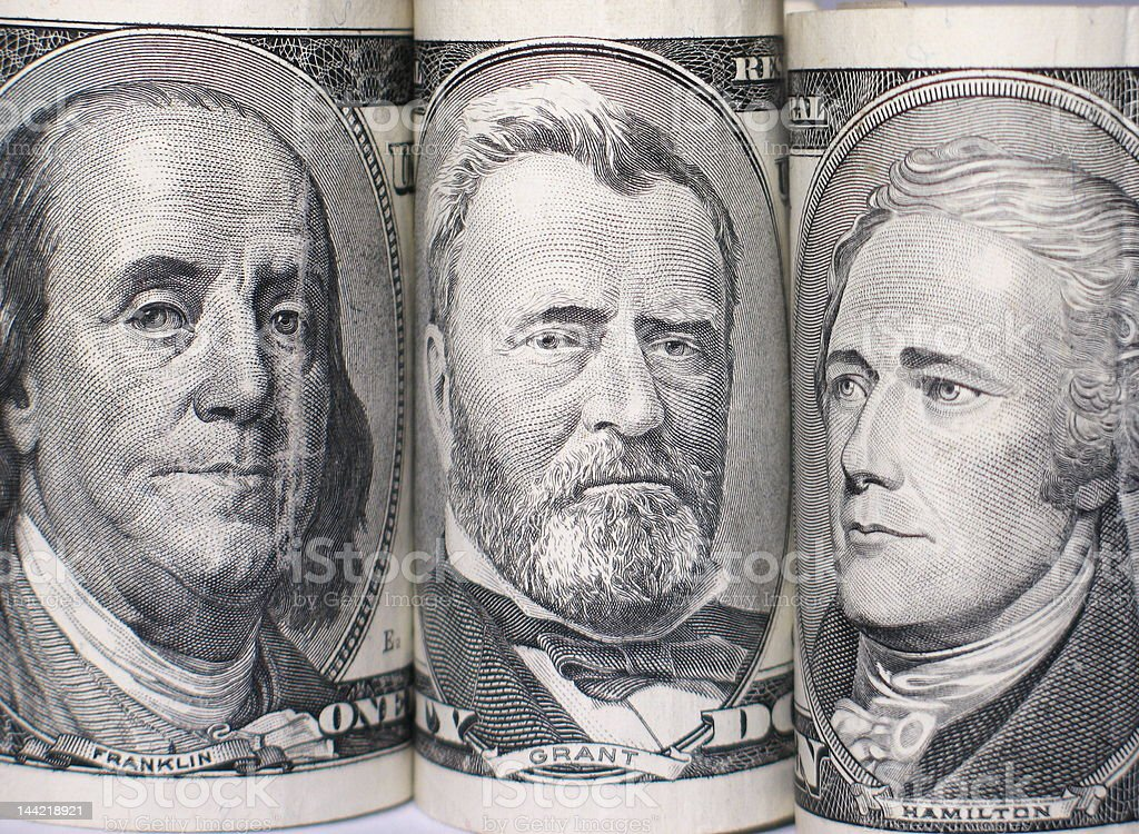 Triplet of banknote portraits stock photo
