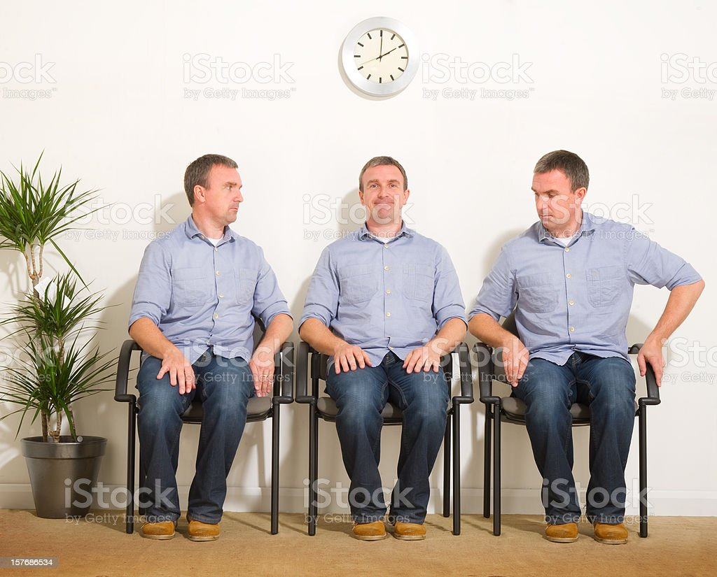 Triplets in a Waiting Room royalty-free stock photo