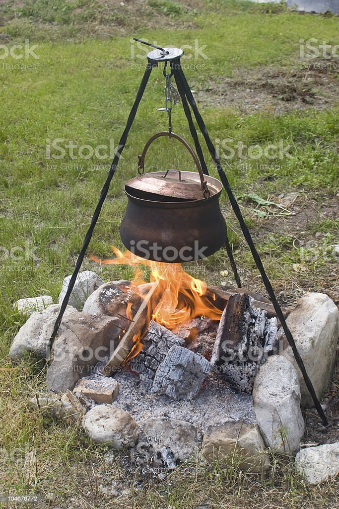 Tripod campfire cooking royalty-free stock photo