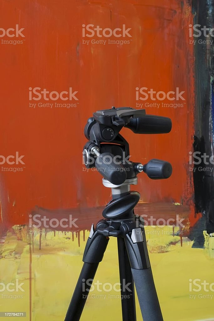 Tripod  in front  of red painting. royalty-free stock photo