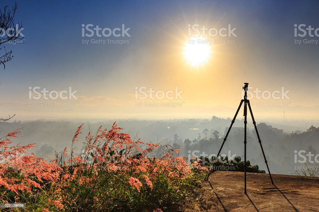 Tripod on the peak hill ready for photography stock photo