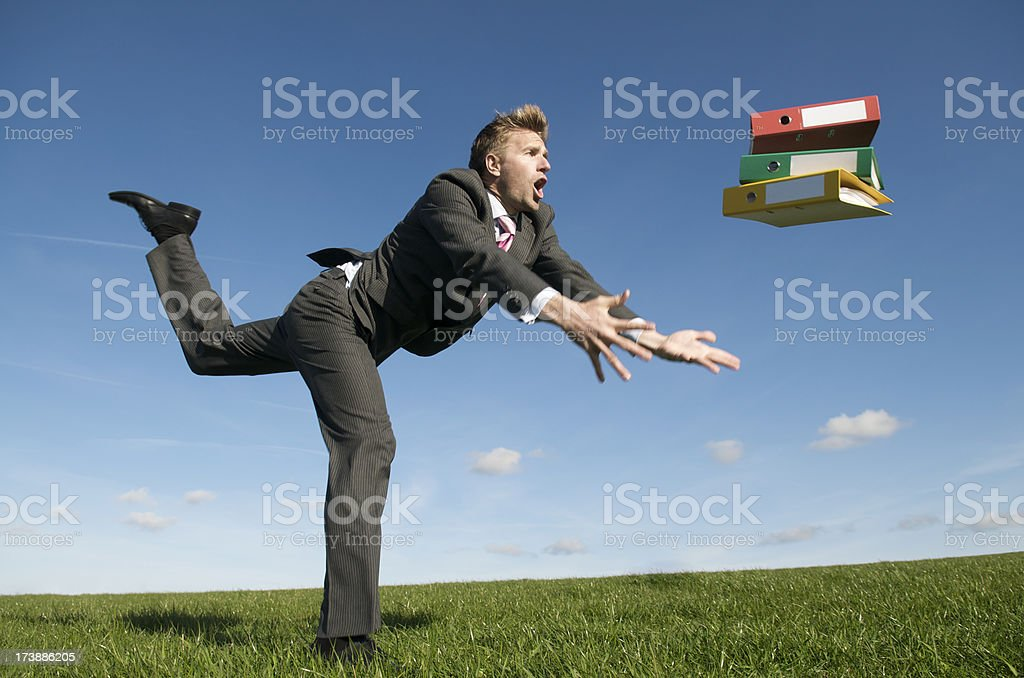 Tripping Businessman Dropping Files Outdoors in Meadow royalty-free stock photo