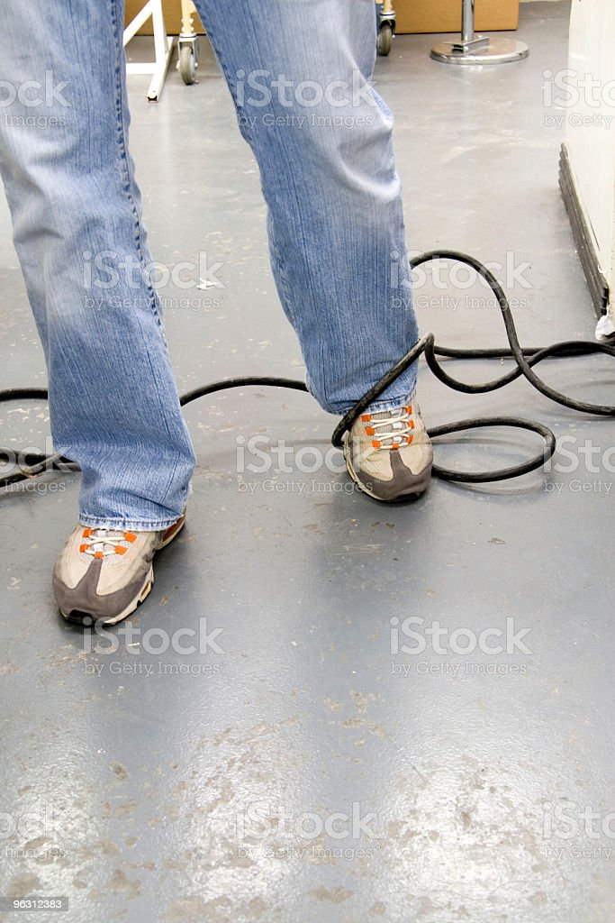 Tripping on an Electrical Cord stock photo