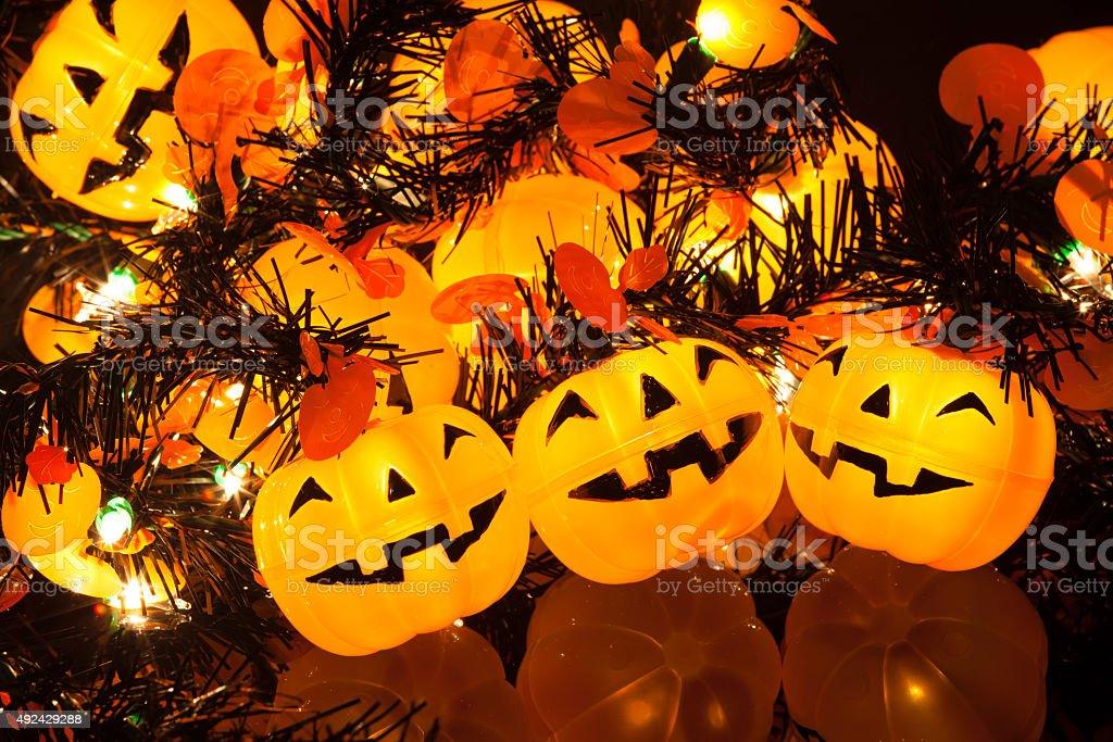 Tripple Halloween pumpkin lights around with friends stock photo