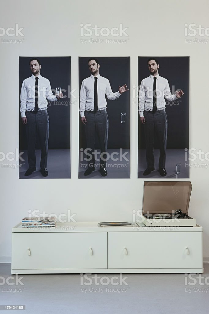 Triptych Above Record Player On Sideboard royalty-free stock photo