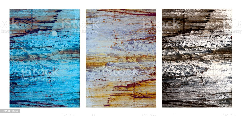 Triptych.Three distressed metal images on white background stock photo