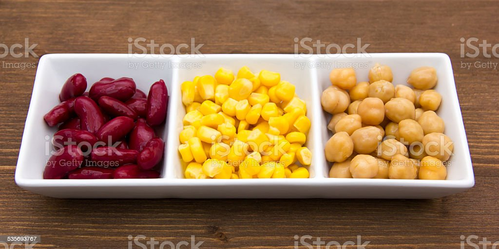 Tris of cooked vegetables on wood stock photo