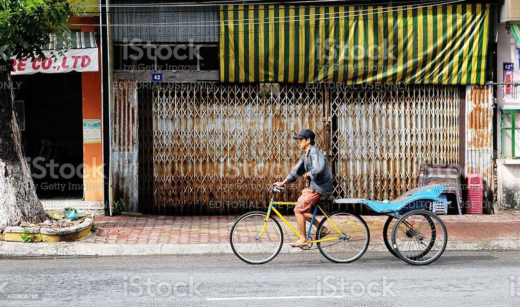Trishaw on street in Chau Doc town, Vietnam stock photo