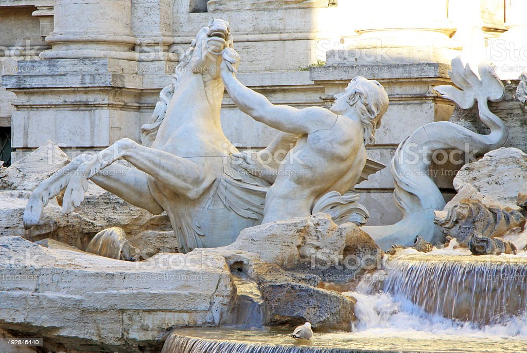 Triton and hippocampus statue, Trevi fountain, Rome, Italy stock photo