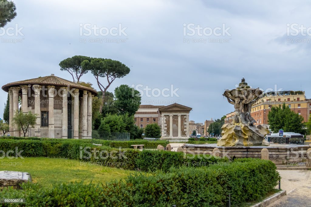 Tritons fountain and Temple of Hercules Victor (Tempio di Ercole Vincitore) on the Forum Boarium at Piazza Bocca della Verita (Mouth of the Truth) - Rome, Italy stock photo
